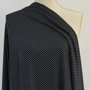 Mini Dots, Double Brushed Poly Spandex, on BLACK (NC)- 1/2 meter