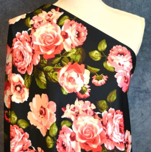 Techno Knit, Kimberely Bright Coral Floral on Black - 1/2 meter