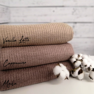 Stack of waffle knit fabric in shades of brown