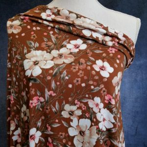 leafy floral on brown double brushed poly fabric