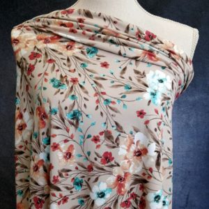 leafy floral on parchment coloured double brushed poly fabric