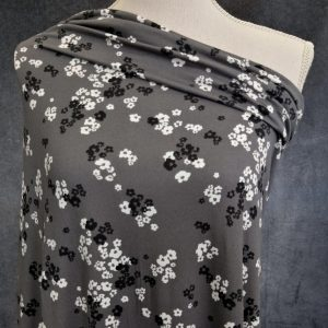 small ivory and black flowers on grey double brushed poly fabric